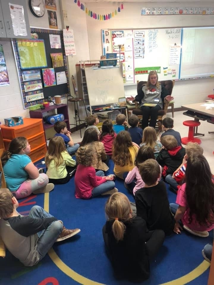 Amy Dull reads to Mrs. Mishler's class.